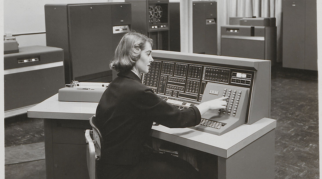 women using vintage computer
