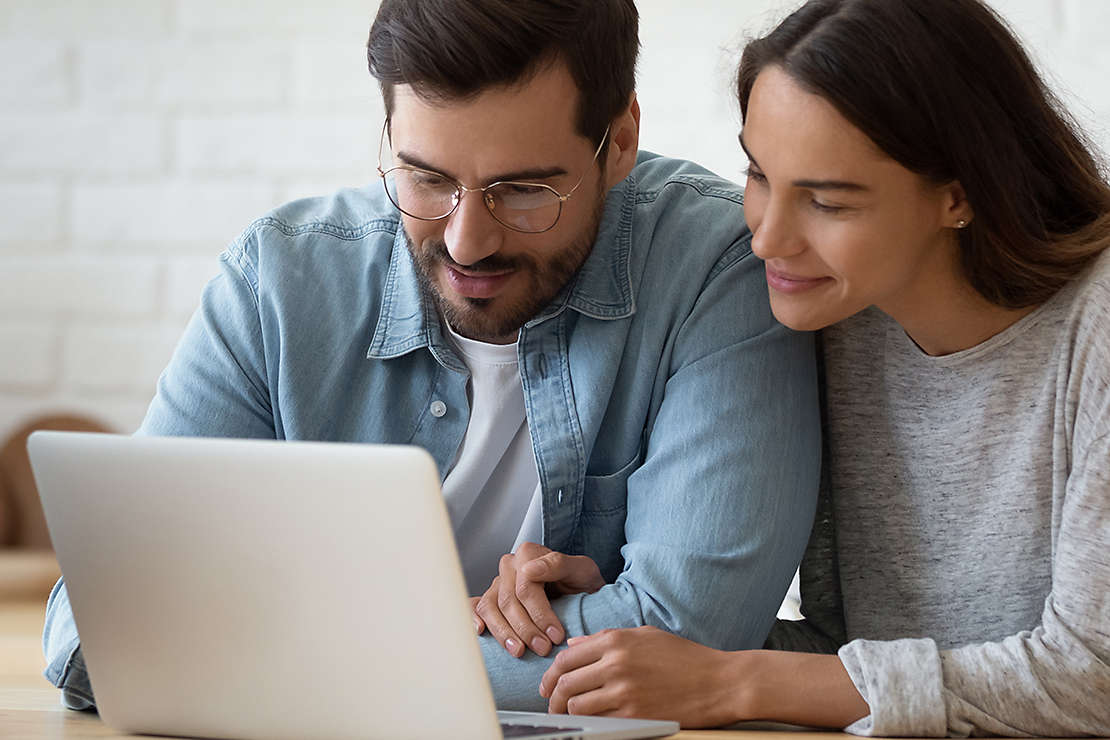 Husband and wife review important documents on a computer