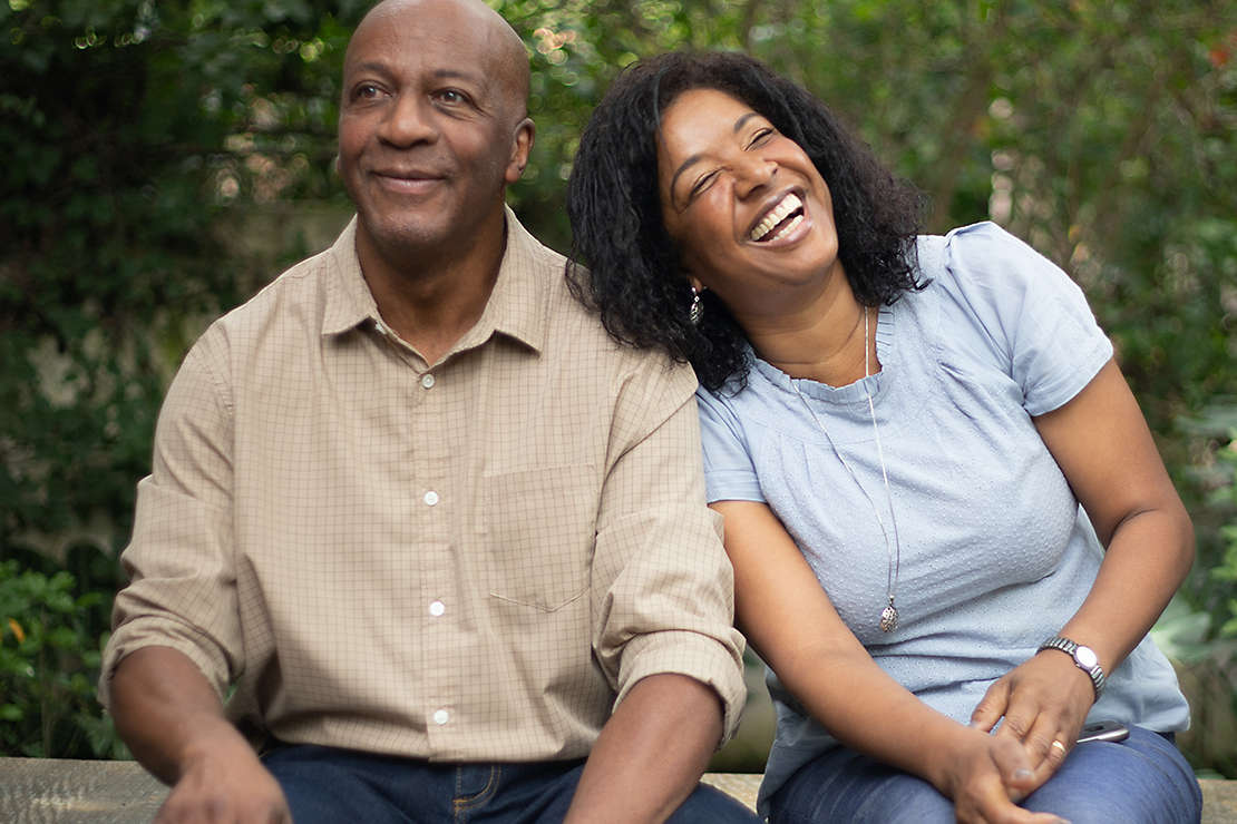 Couple smiling in park