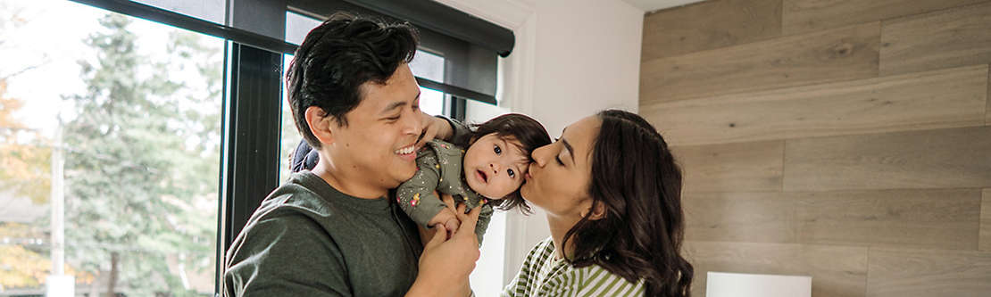 Two people showing affection to child