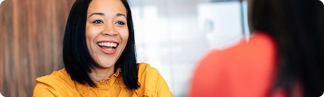 Professional smiling in a meeting