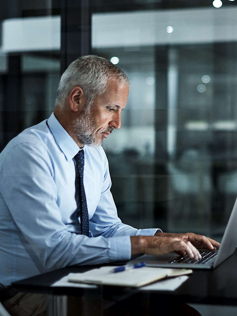 Person typing on laptop computer.