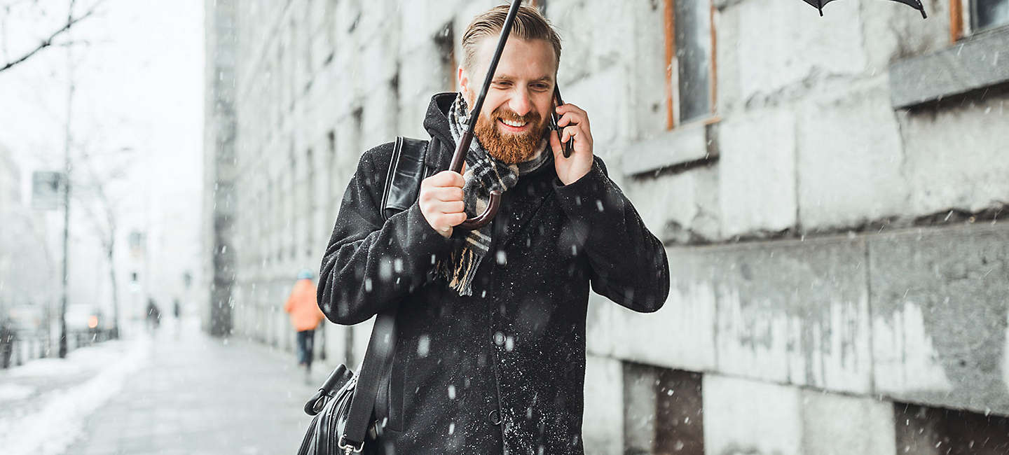 Man talking on phone in the snow