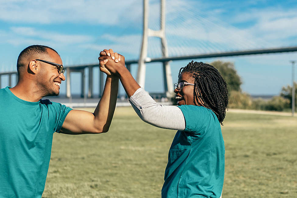 Man and woman high fiving