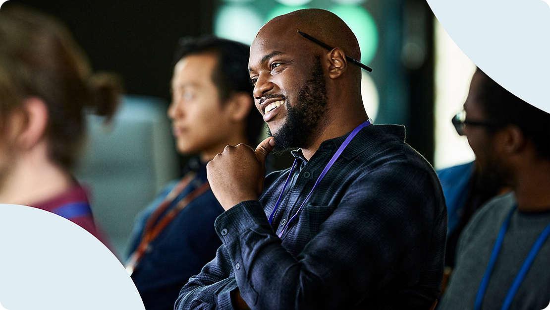 Man smiling in training seminar