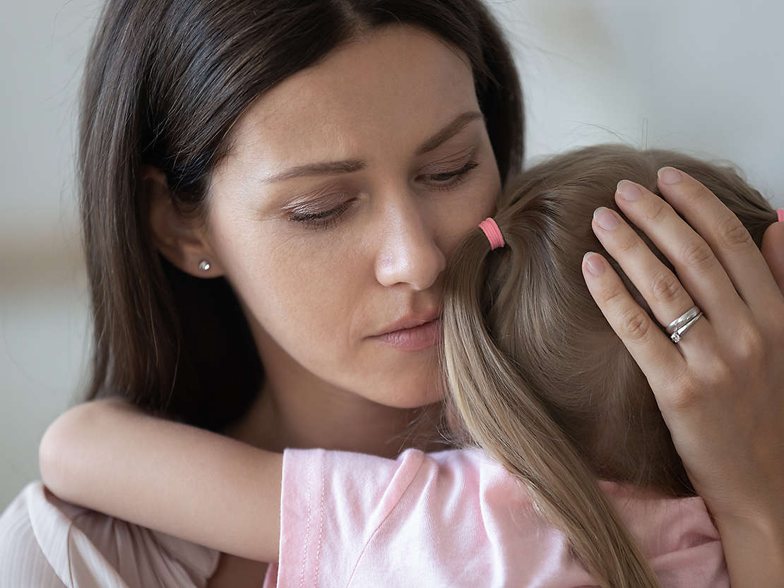 Mother and daughter grieving