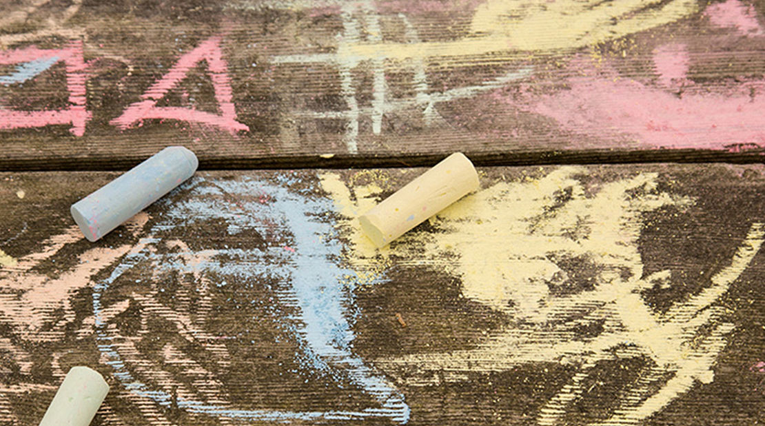 Colored chalk and writing on wood