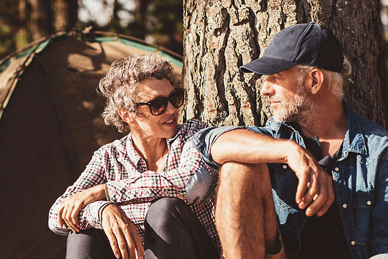 Older couple camping outside