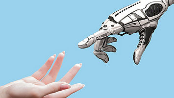 Robot hand and human hand reaching towards each other