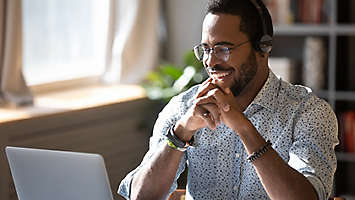 man working on policy over zoom