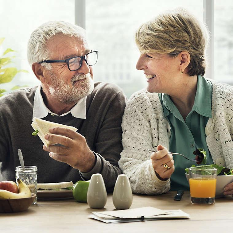 Retired couple eats a relaxing breakfast