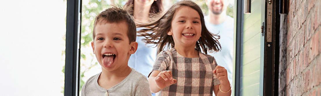 Two small children running inside.