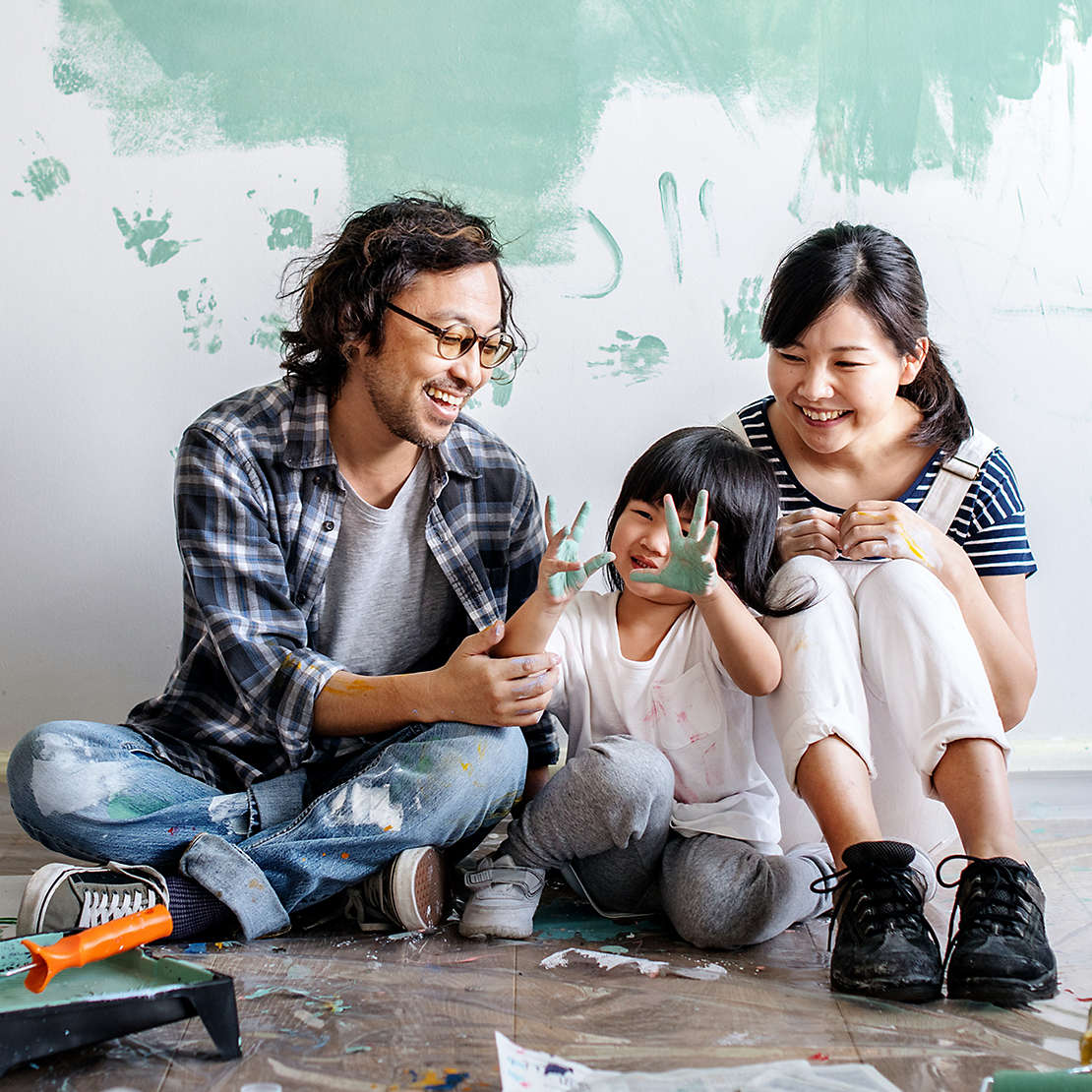 Family painting home with child