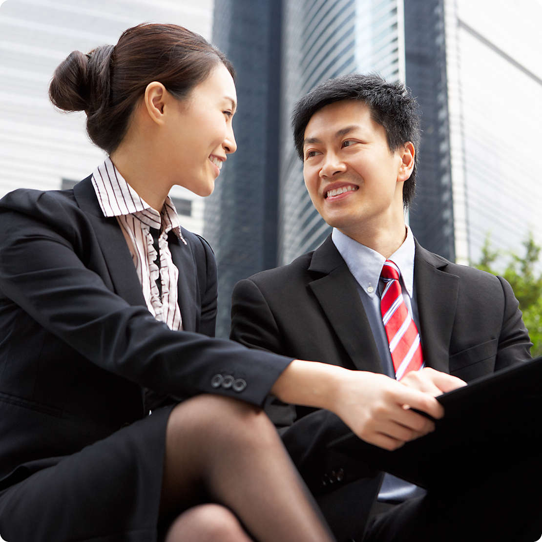 Two employees smiling at each other
