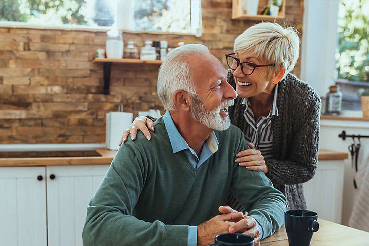 Elderly couple talking in kitchen