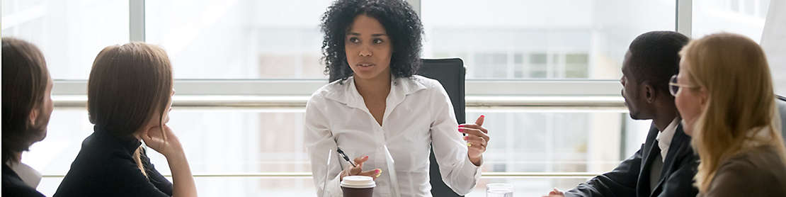 Person presenting notes at conference table