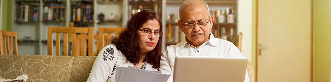 Two people discussing notes on computer