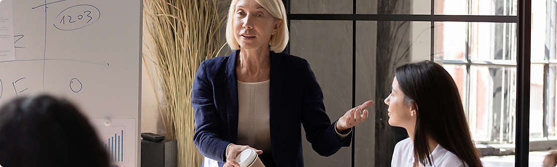Woman presenting to a group of financial professionals