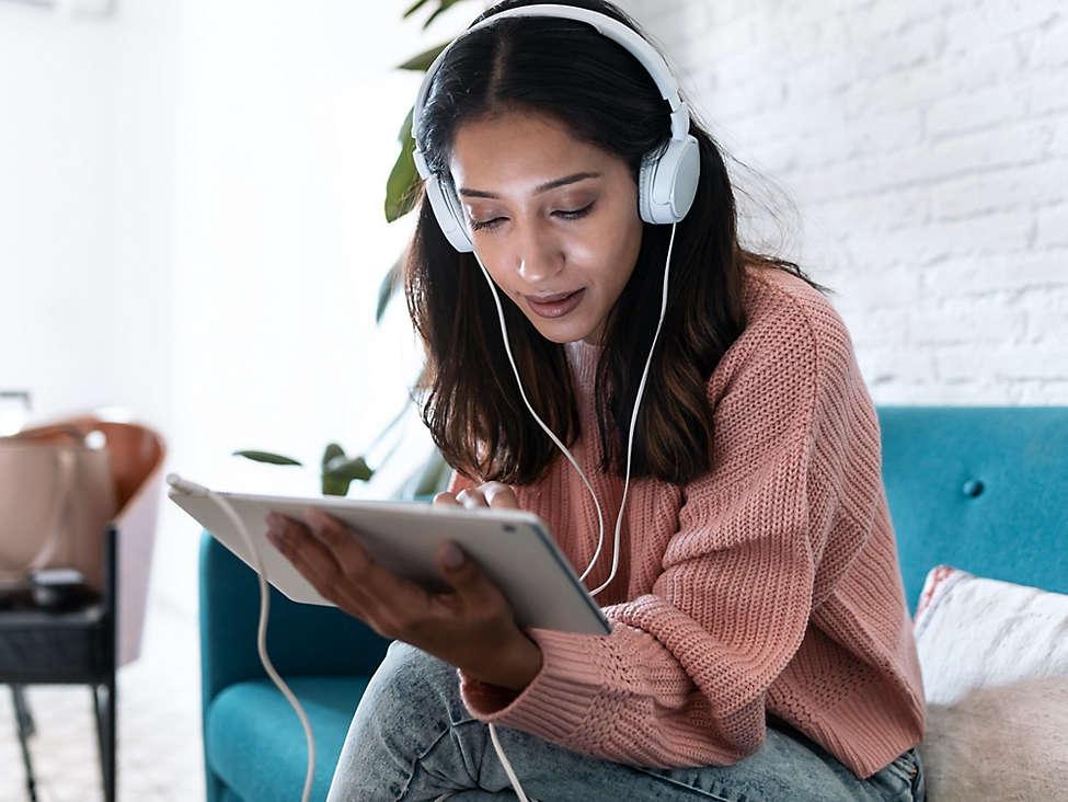 Women listening to music on Ipad