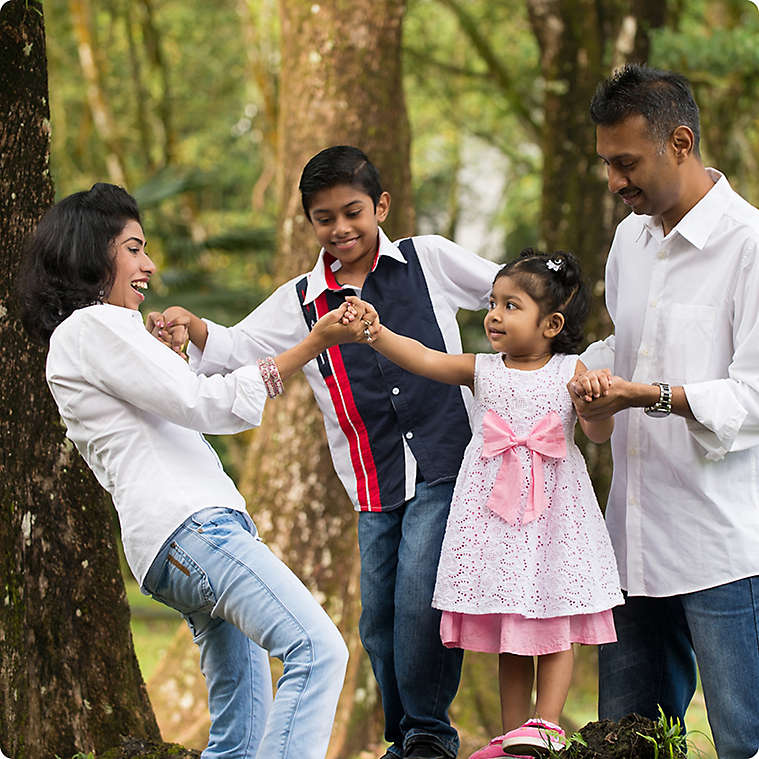 South Asian family walking outside
