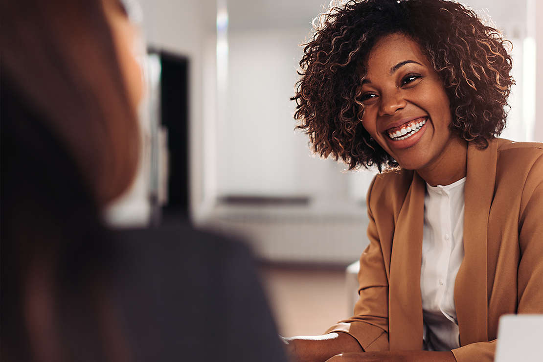 Woman smiling at an agent.