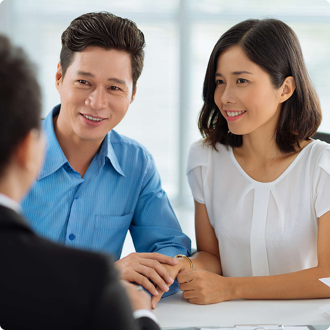 Vietnamese couple meeting with agent
