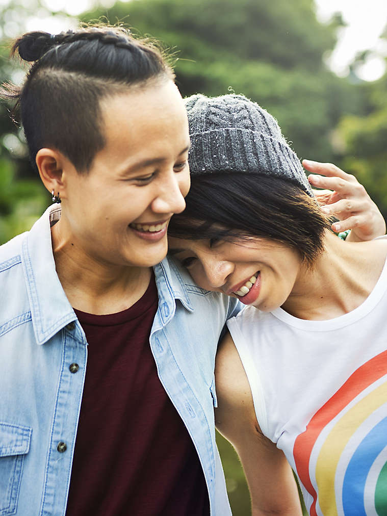 Two people holding each other and smiling