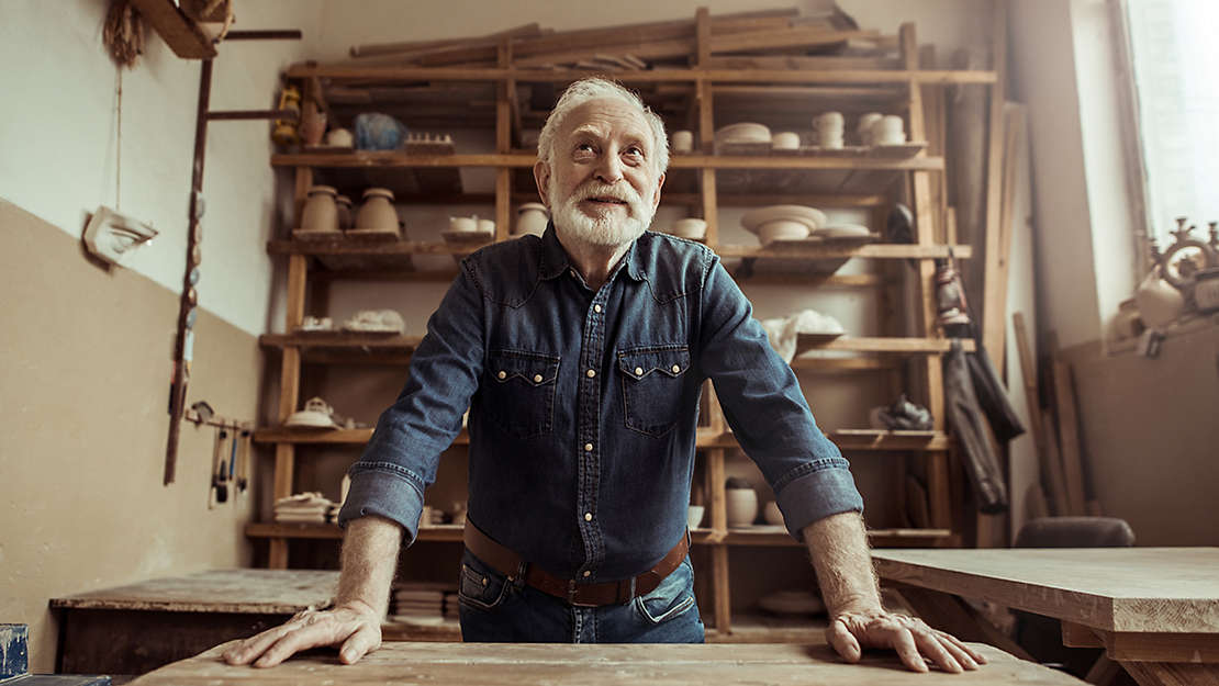 Older man in a pottery studio