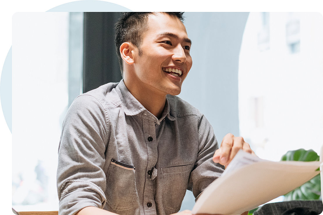 Smiling financial professional holding documents