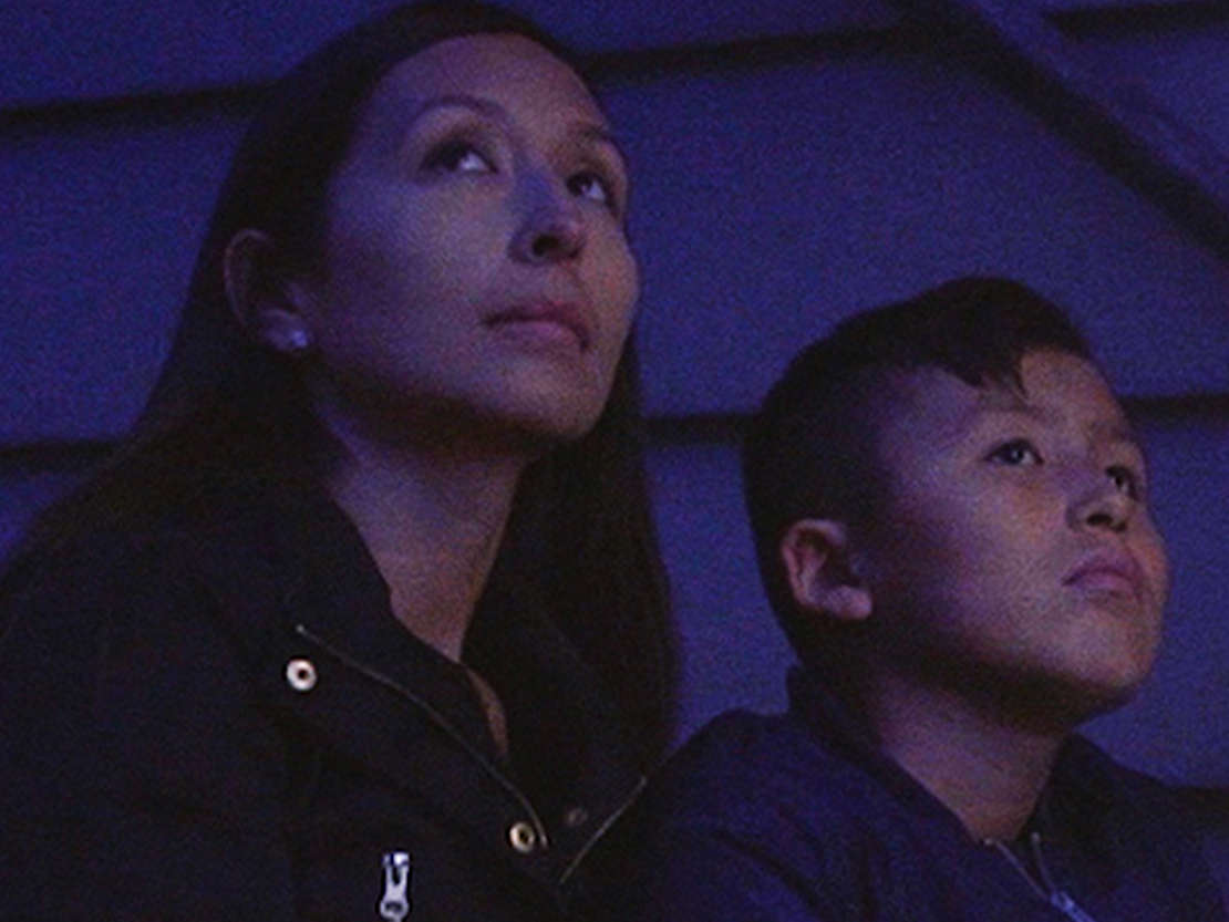Mother and son looking into the sky