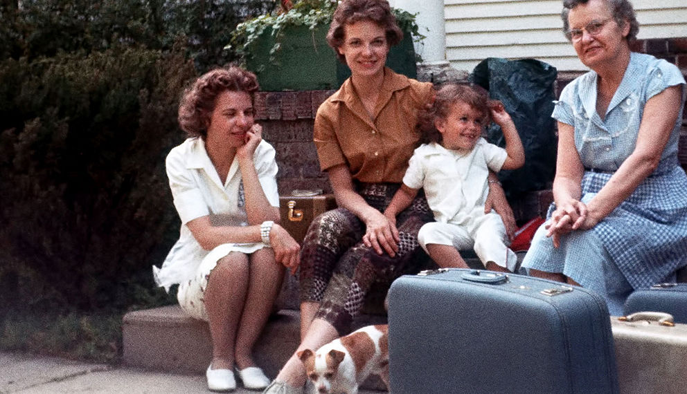3 generations of women sitting outside on porch stairs.