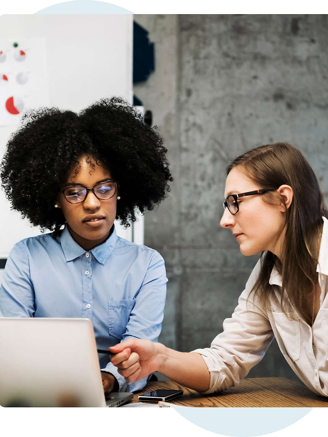Two women discussing in office