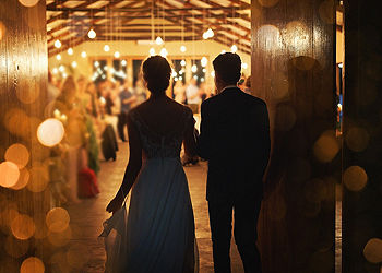 Rearview shot of a young couple arriving hand in hand at their wedding reception