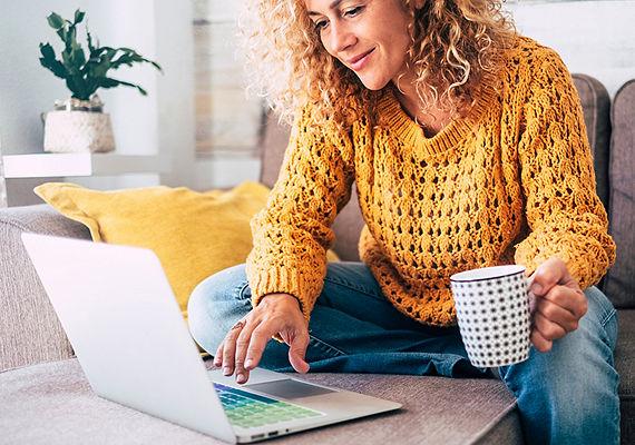 Women on laptop drinking coffee