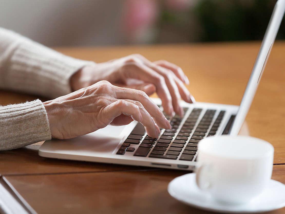 Woman types on laptop