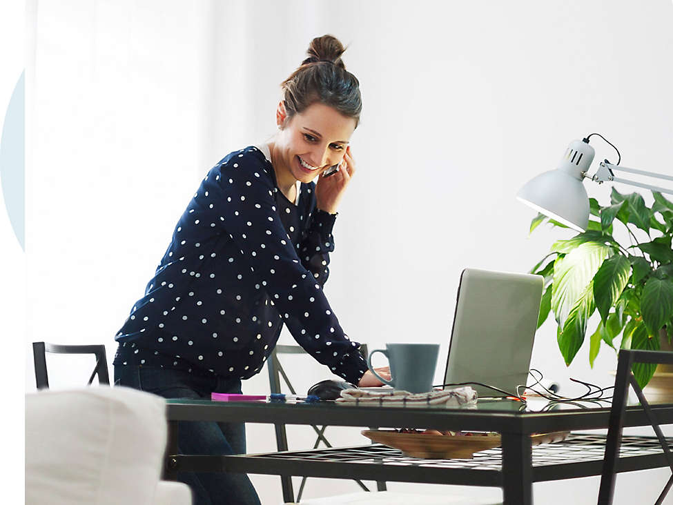 Woman working from home on phone