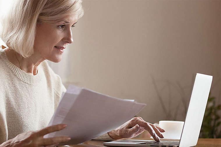 Elderly women working on computer.