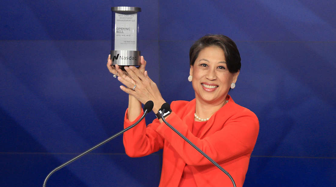 New York Life Investment Management's Yie-Hsin Hung rings the Nasdaq opening bell.